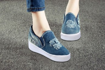 Steps on denim sneakers